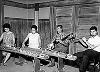 [Koto players, Shinichi Yuize and Yasuko Nakashima, preparing for Budo-Kai Japanese music concert at Mrs. Kyoko Wakita's home, California, August 28, 1966]