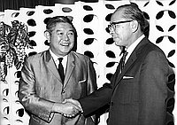 [Shintaro Fukushima shaking hands with Toshiro Shimanouchi, Consul General of Japan, Los Angeles, California, September 1966]