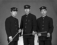 [Three Waseda University students in uniform, three-quarter portrait, Los Angeles, California, November 25, 1966]