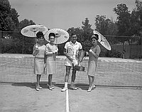 [Tennis player with trophy and Nisei Week Queen and court, California, 1966?]