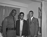 [Young African American man holding baseball, California, 1966?]