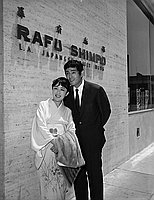 [Japanese movie actors, Tatsuya Nakadai and Kiyoko Miyazaki, in front of Rafu Shimpo, Los Angeles, California, June 2, 1967]