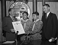 [Los Angeles Mayor Sam Yorty presenting proclamation to Boy Scouts at Los Angeles City Hall, Los Angeles, California, August 2, 1967]
