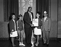 [Los Angeles City Councilman Thomas Bradley presenting City Council resolution to the National Baton Twirling Association, Los Angeles, California, August 21, 1967]
