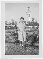 [Candy striper standing outside, full-length portrait, Rohwer, Arkansas, October 16, 1944]