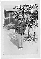 [Boy in Army uniform next to tree, Rohwer, Arkansas, August 6, 1944]