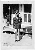[Boy in Army uniform in front of barracks, Rohwer, Arkansas, August 6, 1944]
