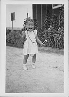 [Girl toddler holding a flower, Rohwer, Arkansas]