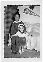 [Toddler in sailor outfit and boy in suit, Rohwer Arkansas, May 24, 1944]