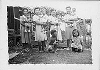 [Women and children outside of barracks, Rohwer, Arkansas]