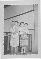 [Two women holding toddlers, Rohwer, Arkansas, July 6, 1944]