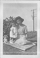 [Toddler and woman on blanket on grass, Rohwer, Arkansas, September 3, 1944]