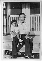 [Man and toddler sitting on porch steps, Rohwer, Arkansas]
