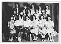 [Group portrait of fifteen women and one man, Rohwer, Arkansas, 1942-1945]
