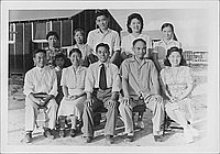 [Group portrait of eleven in front of barracks, Rohwer, Arkansas, 1942-1945]
