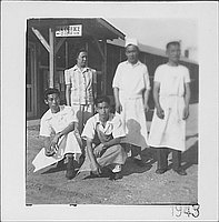 [Woman and four men in aprons, Rohwer, Arkansas, 1943]