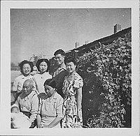 [Group portrait with infant next to shrub, Rohwer, Arkansas, November 9, 1944]