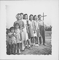 [Group portrait of adults and children standing in a line, Rohwer, Arkansas, September 26, 1943]