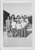 [Group portrait of three adults and five children outside, Rohwer, Arkansas, September 3, 1944]