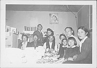 [Soldier and family around table covered with food, Rohwer, Arkansas, December 19, 1944]