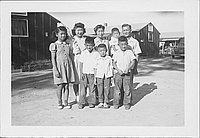 [Three adults and five children outside, portrait, Rohwer, Arkansas, September 3, 1944]