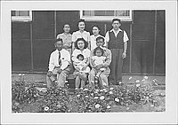 [Famiy of nine and flowerbeds, Rohwer, Arkansas, April 15, 1945]