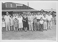 [Large group of people standing in front of mess hall 3, Rohwer, Arkansas, 1942-1945]