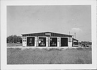 [Automobiles parked in garage, Rohwer, Arkansas, 1942-1945]