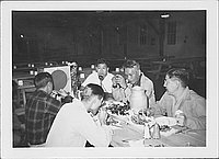 [Five men eating in mess hall, Rohwer, Arkansas, 1942-1945]