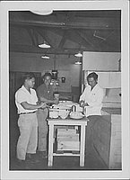 [Three men prepare rice balls in mess hall kitchen, Rohwer, Arkansas, 1942-1945]