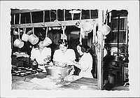 [Three women preparing food in mess hall kitchen, Rohwer, Arkansas, 1942-1945]