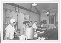 [Men and women preparing plates of food in mess hall, Rohwer, Arkansas, 1942-1945]