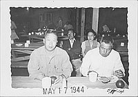 [Two men eating in mess hall, Rohwer, Arkansas, May 17, 1944]