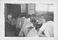[Candy stripers helping with examination of children, Rohwer, Arkansas, July 6, 1944]