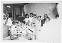 [Men and women standing in line in mess hall, Rohwer, Arkansas, 1942-1945]