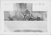 [Display of wood carvings and relief, Rohwer, Arkansas]