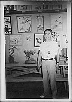 [Man in front of bonsai and artwork, Rohwer, Arkansas, July 22, 1945]