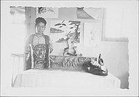 [Man holding artwork of man's head, Rohwer, Arkansas]