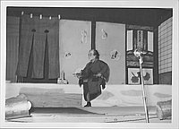 [Man smoking pipe in Kabuki play, Rohwer, Arkansas, October 21, 1944]