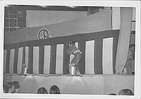 [Man walking in front of striped curtain in Kabuki play, Rohwer, Arkansas]
