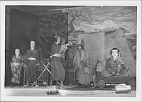 [Man talks to man on boat in Kabuki play, Rohwer, Arkansas]