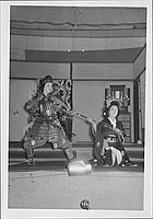 [Warrior and princess grasping bow in Kabuki play, Rohwer, Arkansas, November 11, 1944]