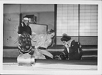 [Couple bending over child in Kabuki play, Rohwer, Arkansas, November 12, 1944]