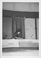 [Young woman leaning over desk in Kabuki play, Rohwer, Arkansas, October 21, 1944]
