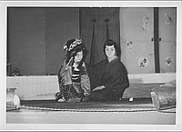 [Seated couple in Kabuki play, Rohwer, Arkansas, October 21, 1944]