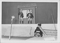 [Porters talking to another commoner in Kabuki play, Rohwer, Arkansas, October 21, 1944]