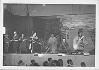 [Cast pulling boat while woman paddles in Kabuki play, Rohwer, Arkansas]