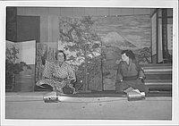 [Two men sitting and talking in Kabuki play, Rohwer, Arkansas]