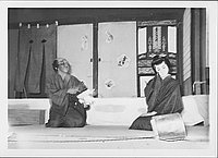 [Old man talking to young man in Kabuki play, Rohwer, Arkansas, October 21, 1944]