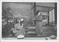 [Man wiping another man's sword in Kabuki play, Rohwer, Arkansas]